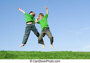happy winning kids jumping in celebration