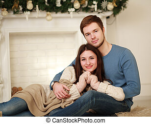 Happy winter couple in love at home
