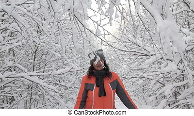 happy winter day woman walking in the woods white snowy...