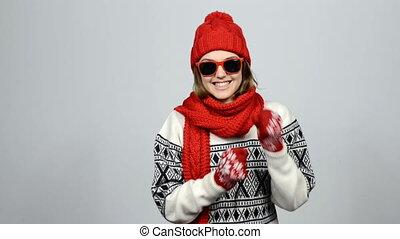Happy winter girl dancing