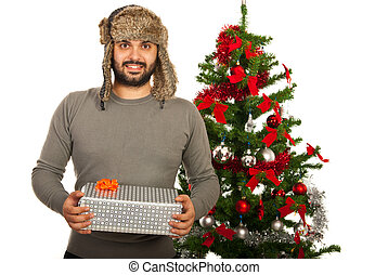 Happy winter man with gift