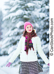 Happy winter women in park snow Christmas lights