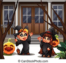 Happy witch couple standing in front of the house