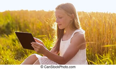 happy with tablet computer on cereal field - internet,...