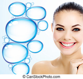 Happy woman against a background with water drops