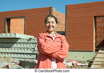 Happy   woman  against  construction work