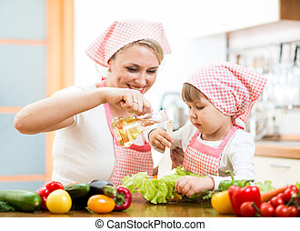 Happy woman and child preparing healthy food together