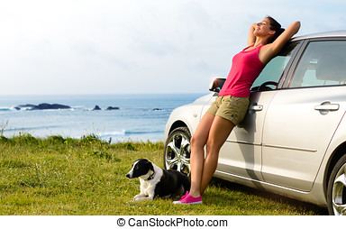 Happy woman and dog travel