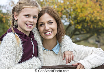 Happy Woman and girl Mother Daughter Smiling