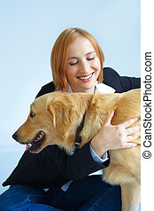 happy woman and golden retriever