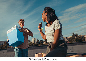 woman and man with portable fridge