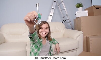 Happy woman apartment owner or renter showing keys - Happy...