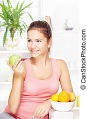 happy woman at home with fruits