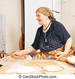 Happy woman at kitchen