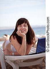 Happy woman at resort beach