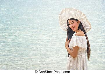 Happy woman at the beach enjoying.