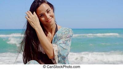 Happy Woman at the Beach Looking at Camera