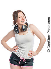 happy woman athlete with headphones on white background