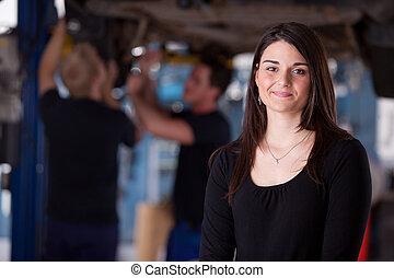 Happy Woman Auto Repair Customer - A happy female auto...