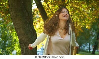 Happy woman autumn park
