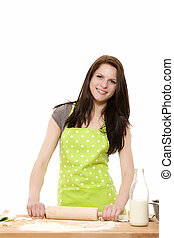 happy woman baking using rolling pin on dough on white background