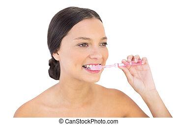 Happy woman brushing her teeth - Happy woman brushing her...