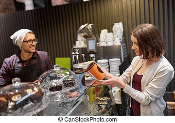 happy woman buying chai latte drink at vegan cafe