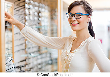 Happy Woman Buying Glasses At Optician Store - Portrait of ...