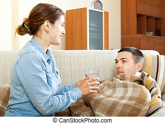 woman caring for sick husband