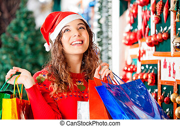Happy Woman Carrying Shopping Bags - Happy woman in Santa...