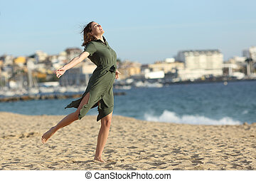 Happy woman celebrating vacation on the beach