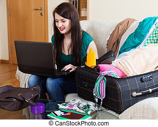 Happy woman choosing resort online