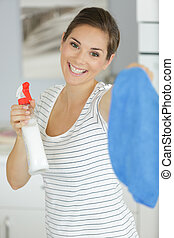 happy woman cleaning at home