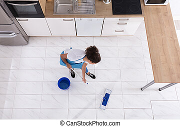 Woman Cleaning Floor With Mop