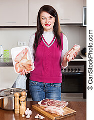 Happy woman  cooking jellied meat with by-products