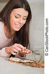 Happy Woman Counting Her Savings