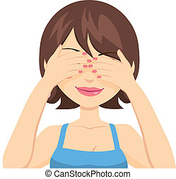Beautiful brunette woman happy covering her eyes expecting a surprise