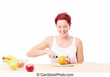 happy woman cutting a orange