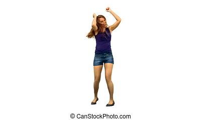 Happy woman dancing in slow motion