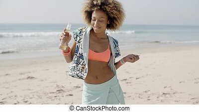 Happy Woman Dancing On A Beach