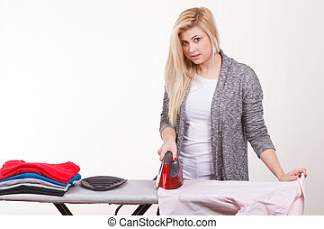 Happy woman doing ironing