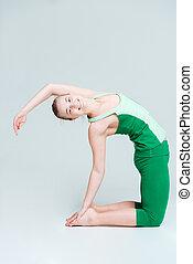 Happy woman doing yoga exercise