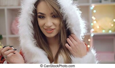 Happy woman dressed in snow-maiden suit singing and dancing in 4K