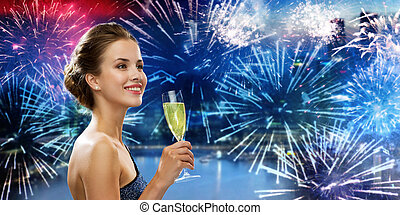happy woman drinking champagne wine over firework