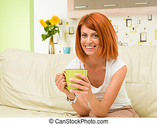 happy woman drinking tea