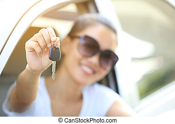 happy woman driver hold car keys