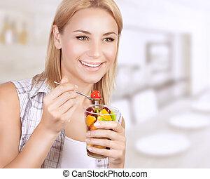 Happy woman eat fruit salad