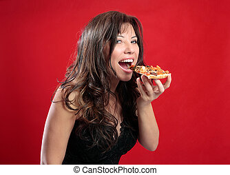 Happy woman eating pizza - A beautiful happy woman eating a...