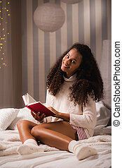 Happy woman enjoying a book