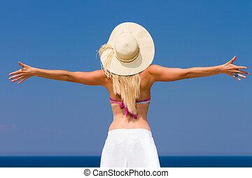 Happy woman enjoying beach